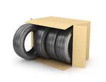Four tires in an open cardboard box, Royalty Free Stock Photography