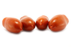 Four tomatoes. Four red tomatoes on the white background Royalty Free Stock Photography
