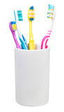 Four toothbrushes in ceramic glass Royalty Free Stock Images