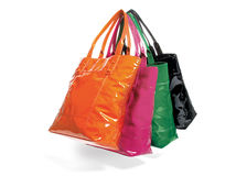 Four tote bags in assorted colors Royalty Free Stock Photos