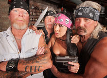 Four Tough Bikers in a Bar Royalty Free Stock Image