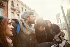Four Tourists Sightseeing City Stock Photography