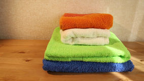 Four towels on a table stock footage