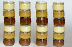 Four tower of six glasses of pudding. White background Royalty Free Stock Images