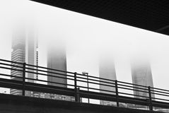 Four towers business area in the mist. Royalty Free Stock Photos