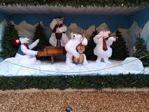 Four toy polar bears make music for children royalty free stock images