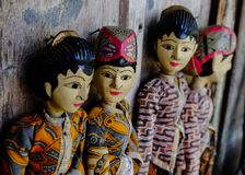 Four traditional Javanese Wayang Golek theatre puppets being sold as sourvenirs in Pawon, Java. Royalty Free Stock Photos