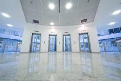 Four transparent elevator door Stock Photo