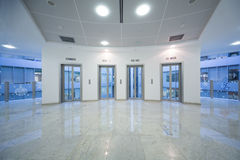 Four transparent elevator door in the business building royalty free stock photography