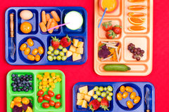 Four trays filled with fruit and vegetables royalty free stock photos