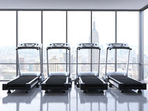 Four treadmills with NY view Stock Images