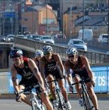 Four triathlon cyclist is a shape curve Royalty Free Stock Photo