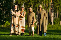 Four trolls in the forest. Costume dress up by 3 men and a woman Royalty Free Stock Image