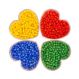 Four types of beads. In a box in the form of heart Stock Photography