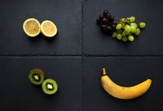 Four types of fruit on slate table royalty free stock photo