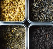 Different types of tea. Four types of loose teas. Black tea with orange, green with fruits, clean green tea and camomile tea stock photo