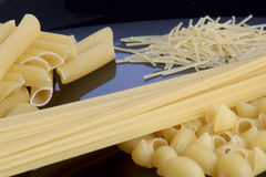 Four types of pasta on a black plate. Closeup Stock Image