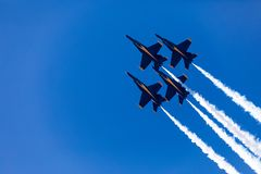 Four U.S. Navy Blue Angels in diamond formation stock images