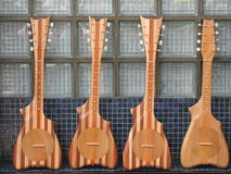 Four ukuleles. On sale at the market of Papeete Stock Photo