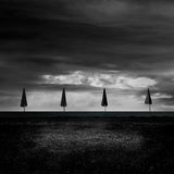 Four umbrellas on the beach