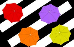 Four umbrellas on stripes background Royalty Free Stock Photo