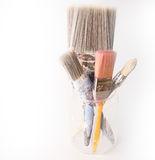 Four used decorating paintbrushes in a jar Royalty Free Stock Images