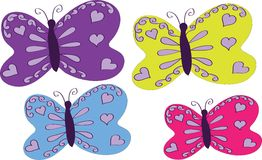 Four varicoloured butterflies Stock Photos