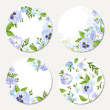Four vector circle cards with blue and purple flowers. Eps-10. Stock Photos