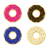 Four vector donuts in multi-colored glaze Royalty Free Stock Photography