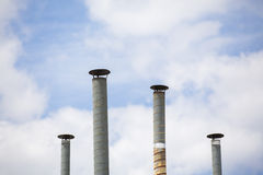 Four ventilation pipes over blue sky Royalty Free Stock Images