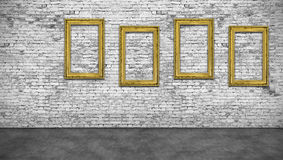 Four vertical golden frames. On white brick wall Royalty Free Stock Image