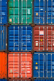 Four vertical rows of shipping containers. That are different colors in the Port of Zeebrugge, Belgium Stock Image