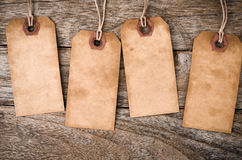 Four vertical Vintage Paper Label on Wood. Background Royalty Free Stock Photos