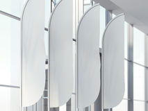 Four vertical wind banners in office. 3d rendering Royalty Free Stock Photo