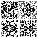 Four vintage foliate ornament designs Stock Photos