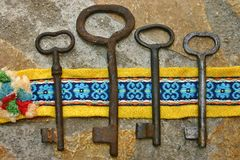Four vintage rusty keys. Four very old and rusty vintage keys Royalty Free Stock Image