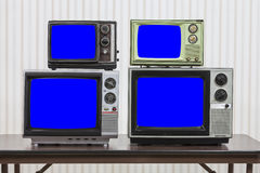 Four Vintage Televisions With Chroma Key Blue Screens Royalty Free Stock Image