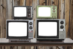 Four Vintage Televisions With Cut Out Screens and Old Wood Wall Stock Photo