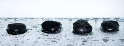 Four volcanic polished stones  zen Stock Photo