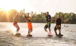 Four wake bord riders having fun Royalty Free Stock Image
