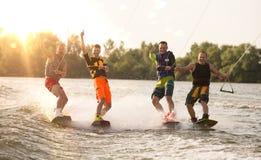 Four wake bord riders having fun Royalty Free Stock Image