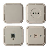 Four wall mounted electrical plates Royalty Free Stock Image