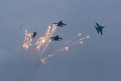 Four war jet planes in sky. Four war jet planes in evening sky. Russian military jet planes launches anti-missile Stock Image