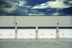Four Warehouse Gates. Four Warehouse Truck Docks. Business Park Theme. Horizontal Photo Royalty Free Stock Photos