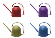 Four watering cans Stock Image
