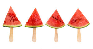 Four watermelon slice popsicles isolated on white, fresh summer fruit concept. Four watermelon slice popsicles isolated on white background, fresh summer fruit royalty free stock photo