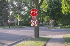 Four Way Stop Sign With One Way In American Suburb Royalty Free Stock Photography
