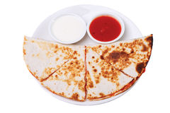 Four wedges sincronizada on a white plate Royalty Free Stock Images