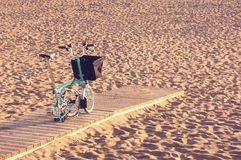 Four wheel bicycle on beach Royalty Free Stock Photography