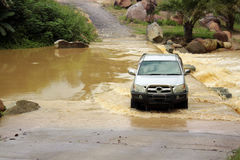 Four wheel car cross the river Royalty Free Stock Images